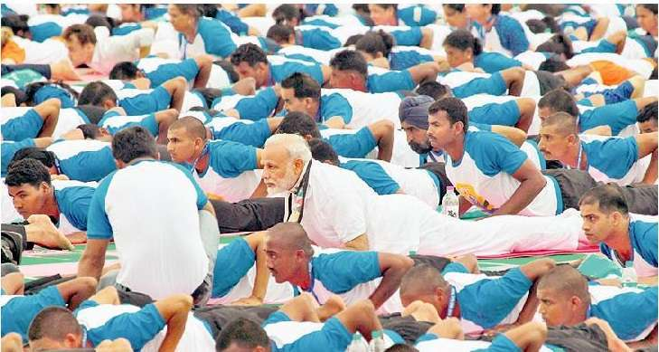 MASS APPEAL: Narenda Modi is joined in a yoga pose by over 30,000 people at the event in Chandigarh