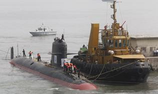 File photo of Indian Navy's Scorpene submarine INS Kalvari being escorted by tugboats as it arrives at Mazagon Docks Ltd, a naval vessel ship building yard, in Mumbai