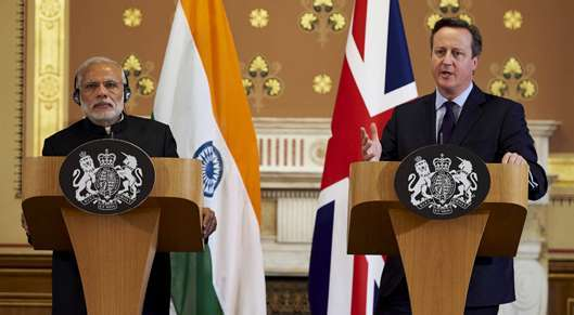 PACKED SCHEDULE: Narendra Modi and David Cameron address a joint press conference